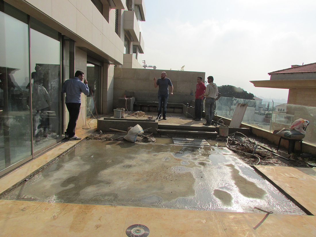 Concrete pouring for slab and planters.